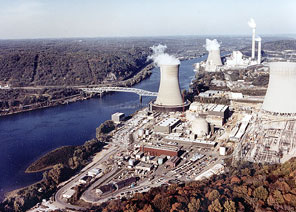 Shippingport Atomic Power Station, America's first full scale nuclear power plant, is in the foreground of this photo; the oblong red building is the above-ground portion of this mostly below-ground plant.  The newer Beaver Valley nuclear plants are behind.