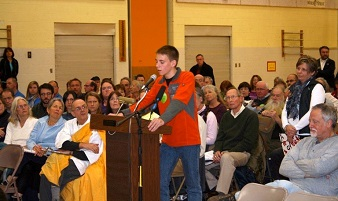 Evan Twarog testifying at Vermont Public Service Board hearing last fall.  Mother in line behind him