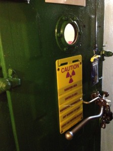 After exiting the galley and viewing some crew spaces, we found, in an athwartships passageway, the first 'real' nuclear component on the ship; the entry door to the reactor plant containment.  Photo for ANS by Will Davis.
