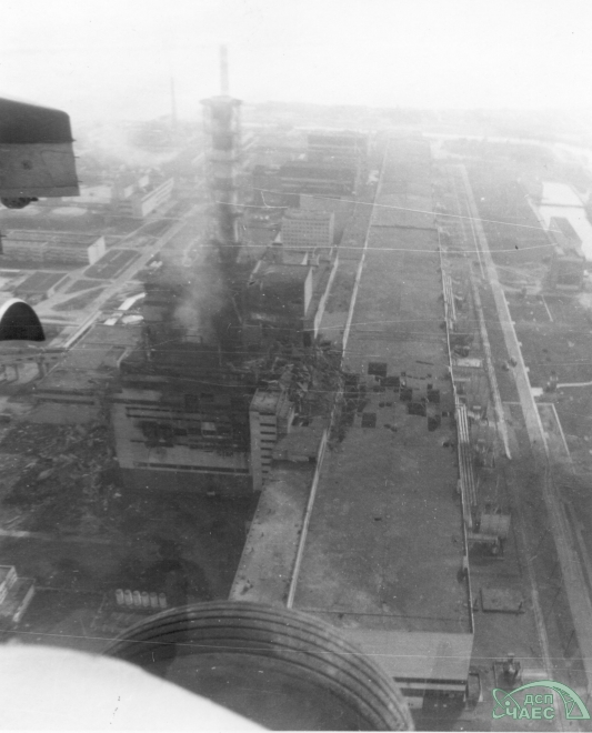 Chernobyl Unit 4 the morning after the accident, taken from a helicopter.  Note damage to reactor building and turbine building.  Courtesy SSE ChNPP.