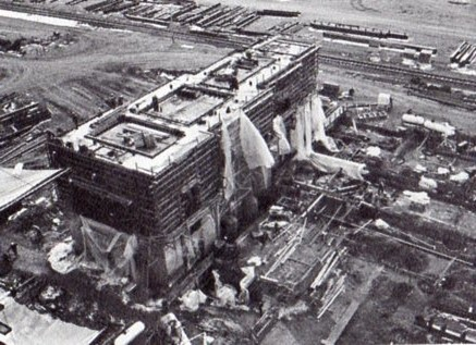 """Aerial view of turbine - generator pedestal under construction for the Fort St. Vrain plant."""