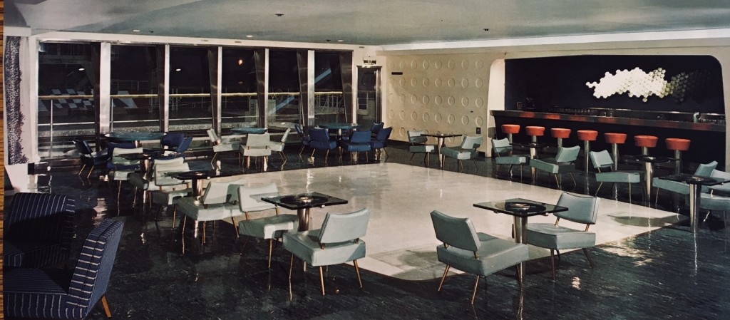 """""""The Veranda"""" on board NS SAVANNAH as it originally appeared.  The tables surrounding the dance floor had Lexan plastic tops which were internally illuminated.  The windows, facing aft, looked over a swimming pool and shuffleboard area."""
